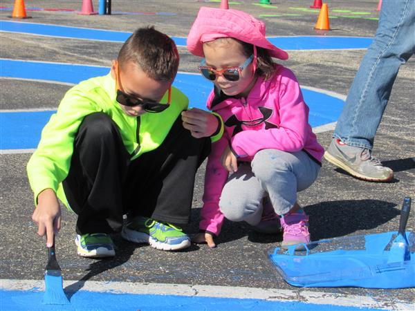 Primary Students paint playground